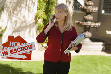 Lady holding papers with escrow sign as seller refuses to sign closing papers