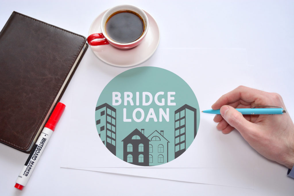 Bridge loan document with coffee and notebook