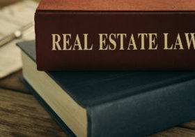 book that read real estate law on spine